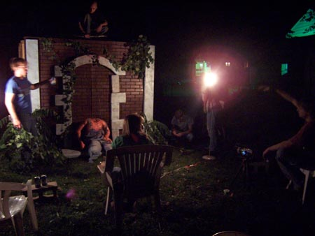 Jason Butler, Bradley Ledbetter (on tomb), Annie Fitzgerald, Jim Mefford, Michelle Jones, and Mark Peaslee set up a special effects shot for WEREWOLF CEMETERY